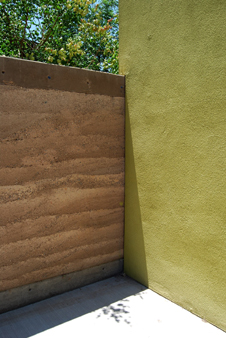 Rammed earth and stucco wall, NM